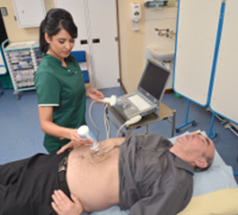 A healthcare provider conducting an abdominal ultrasound on an elderly male patient.